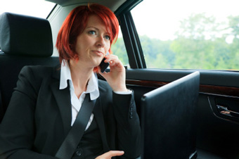 Photo of a business woman in a limo