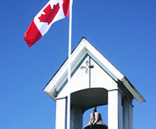 Photo of Church Steeple with Canadian Flag