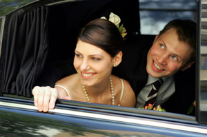 Photo of Newlyweds in the Limo